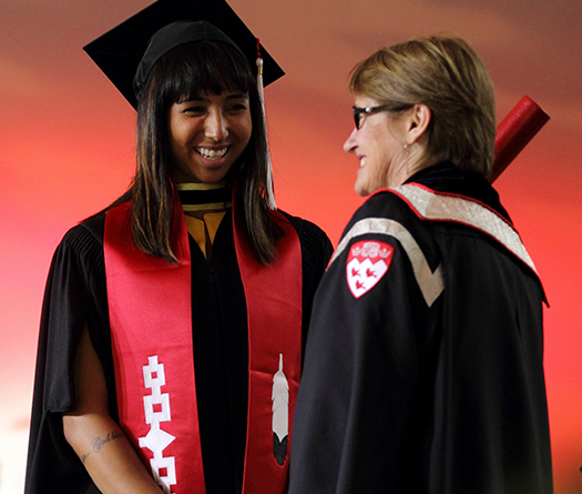 Indigenous graduate receiving her diploma from McGill Principal, Suzanne Fortier