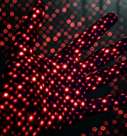 Hand with red lights to illustrate McGill artificial intelligence and data science
