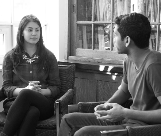 McGill students having conversation in an office setting to illustrate peer support, wellness and student advising