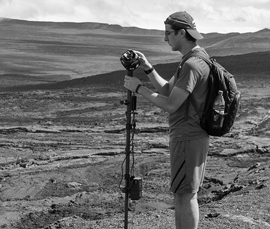 Student researcher with special camera studying geology through experiential learning at McGill